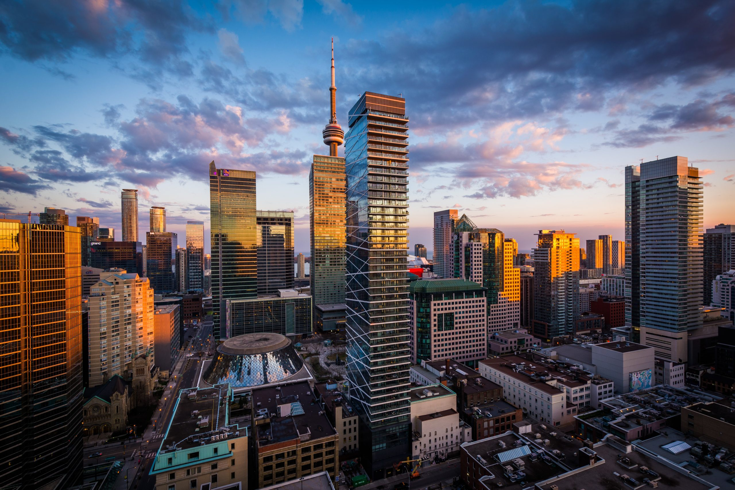 View of modern buildings at sunset in downtown Toronto, Ontario.