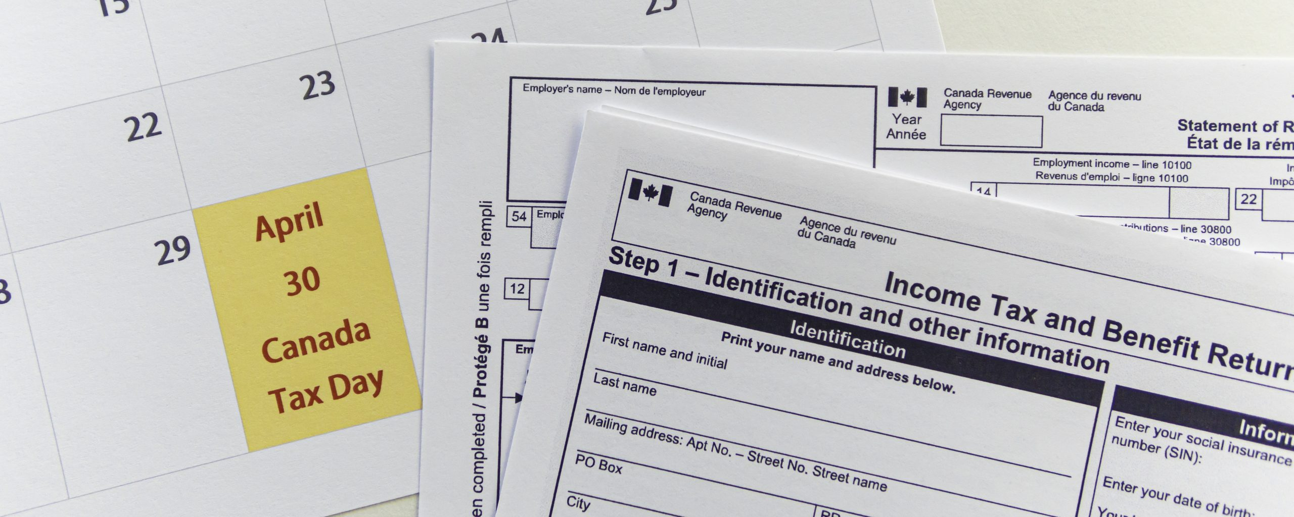 Canada Tax forms with Calender showing Canada Tax day - April 30